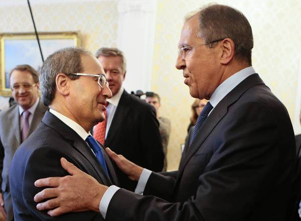 Russian Foreign Minister Sergei Lavrov, right, greets Syrian Deputy Foreign Minister Faysal Mekdad in Moscow.