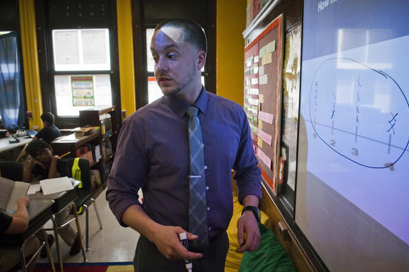 Mario Marrero, Hartford's 2013 Teacher of the Year, instructs a group of students in his fourth-grade class at Betances STEM Magnet School this month.