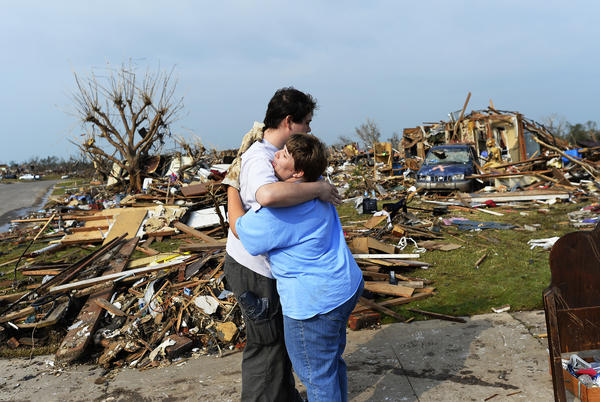 Rachel Swyear hugs a volunteer who helped her salvage belongings from her tornado-devastated home in Moore, Oklahoma. The tornado killed 24 people, injured more than 375 people and damaged 1,200 homes.