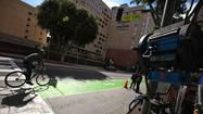 Toning down the green of the Spring Street bike lane