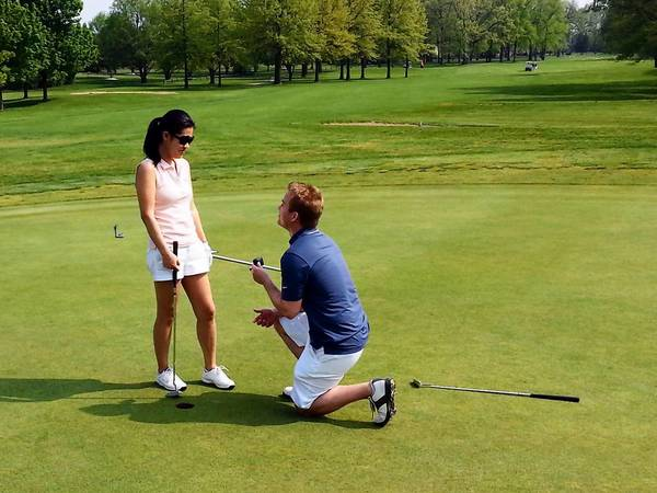 In this Deerfield Golf Club photo, Ahren Wietzke bends on one knee to propose to his girlfriend, Joanna Lombard, on the 18th Green on May 18.