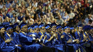 Lyman High School's 458 graduates sat in alphabetical rows, tassels on their blue caps uniformly hanging to the right, eyes focused forward on the stage they were about to cross.