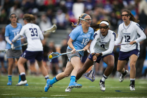 North Carolina's Abbey Friend shoots and scores as Northwestern's Taylor Thornton defends during the first half.