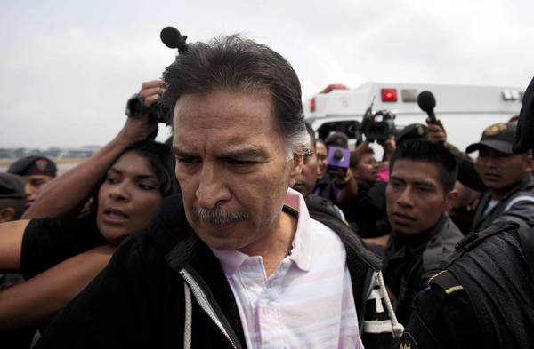 "Former Guatemalan President Alfonso Portillo is escorted by police in Guatemala City before being flown to the U.S. He called his extradition a ""kidnapping."""