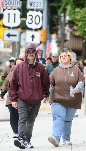 Andrew Naugle, left, and Shelley Grezner lead the 13th annual Walk The Walk for mental wellness event after the Rally on The Square at the Courthouse in Chambersburg Friday morning.
