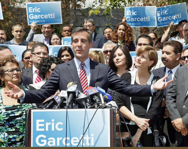 "Los Angeles Mayor-elect Eric Garcetti speaks at a news conference. Garcetti says he's going to focus like a ""laser beam"" on the economy when he takes office July 1."