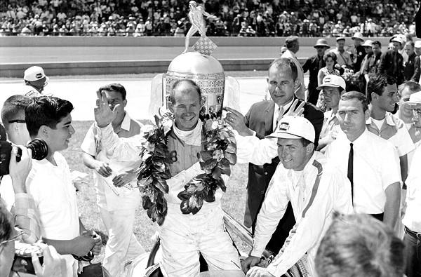 Wreath-wearing Parnelli Jones celebrates his victory in the 1963 Indianapolis 500.