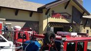 One of two employees injured in an explosion at the La Cañada Flintridge Sport Chalet on March 1 is suing the company.