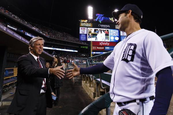 Tigers starter Anibal Sanchez shakes hands with team president and general manager David Dombrowski after the game.