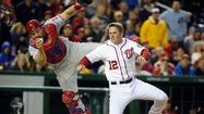 WASHINGTON - Steve Lombardozzi had three hits and Jordan Zimmermann became the National League's first eight-game winner as Washington used a big fifth inning to beat Philadelphia 5-2 on Friday in the teams' first meeting of the season.