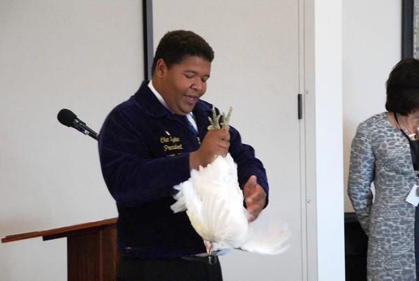 "Oke Iyeke of Westminster High School holds up ""Mr. Chicken"" during a presentation for the Orange County Fair Board on Thursday."