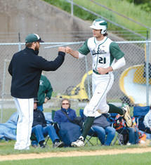 North Star's Tony Strasiser is congratulated by third base coach Mike Blucas after hitting a two-run home run against Southern Fulton in the District 5 Class A playoffs on Friday in Bedford.