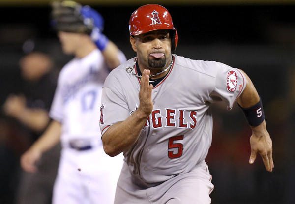Angels first baseman Albert Pujols advances to third base on a flyout by teammate Josh Hamilton in the seventh inning Friday night at Kansas City.