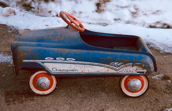 This blue pedal car recently had a change of ownership.