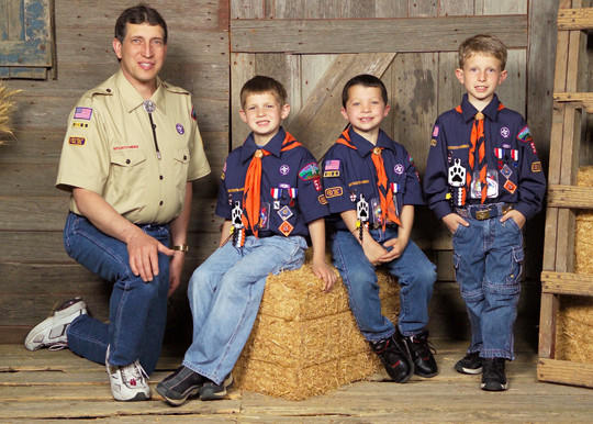 Tim Malsom, left, served as the troop leader for the Cub Scout troop that Collin Rumpca, second from left, Shane Geist, center, and Malsom's son, Spencer, right, participated in during elementary school. Malsom lost his battle to lung cancer in 2011, but the boys continued on in scouting and have achieved the rank of Eagle Scout. Their Court of Honor ceremony will be June 1.