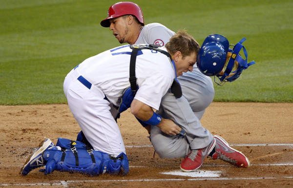 Cardinals center fielder Jon Jay collides with Dodgers catcher A.J. Ellis while scoring on a double by teammate David Freese in the second inning Friday night.