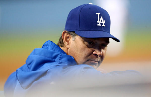 Don Mattingly was backed by Dodgers President Stan Kasten on Friday, but the manager's club showed little fight in a 7-0 loss to the Cardinals.