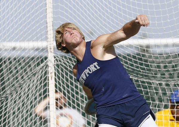 Newport Harbor High senior thrower Marty Taylor throws the discus during the CIF Southern Section Masters meet at Cerritos College on Friday.