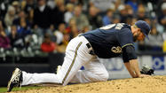 Milwaukee Brewers closer Jim Henderson strained his right hamstring in the ninth inning of Friday night's game against the Pittsburgh Pirates.