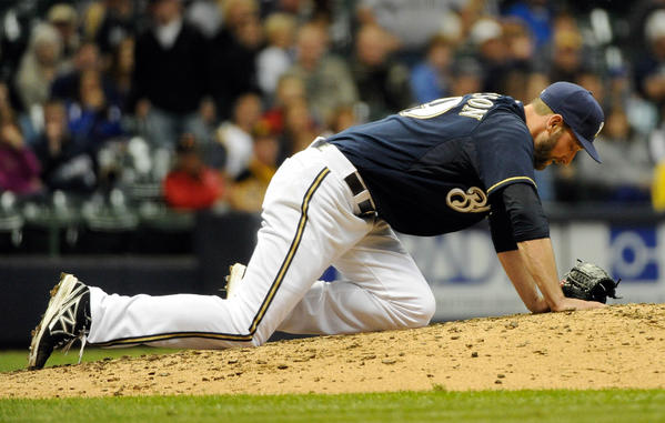 Milwaukee Brewers pitcher Jim Henderson reacts after hurting his leg in the 9th inning during the game against the Pittsburgh Pirates at Miller Park.