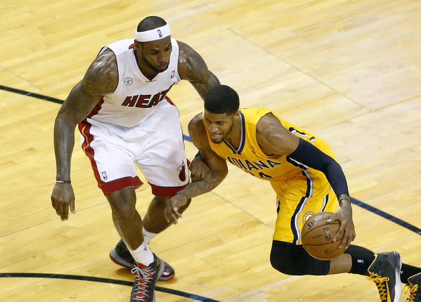May 24, 2013; Miami, FL, USA; Indiana Pacers small forward Paul George (24) dribbles the ball as Miami Heat small forward LeBron James (6) defends in the third quarter of game two of the Eastern Conference finals of the 2013 NBA Playoffs at American Airlines Arena.