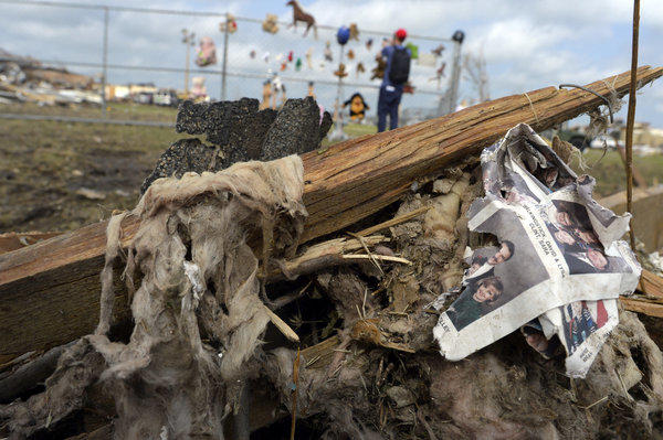 A picture book is seen in debris near a makeshift memorial on the grounds of the Plaza Towers elementary school in Moore, Okla.