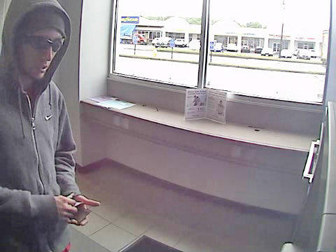A surveillance image of the suspect in the Peoples Bank robbery at Tri-City Plaza in Vernon Saturday.