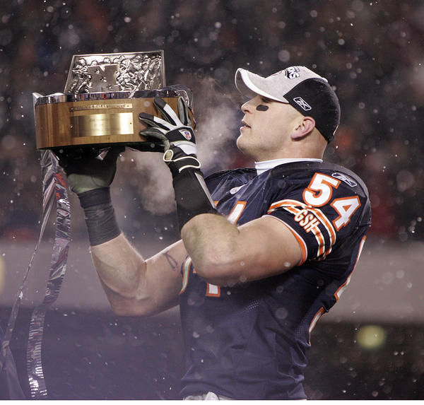 Brian Urlacher holds up the George Halas Trophy after the Bears beat the Saints 39-14 in the NFC Championship game at Soldier Field on January 21,2007.