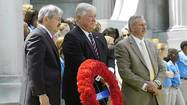 Iowa Gov. Branstad, former Mississippi Gov. Barbour, and Deputy Regional Director of the National Park Service, Benge, stand at a rededication of the Iowa Monument at the Vicksburg National Military Park in Vicksburg