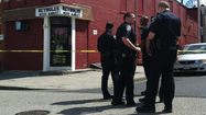Baltimore police said an officer who was integral in arresting a suspect in the Cherry Hill shooting that killed a 1-year-old boy Friday night shot a suspect connected to a Saturday afternoon shooting near a downtown deli.