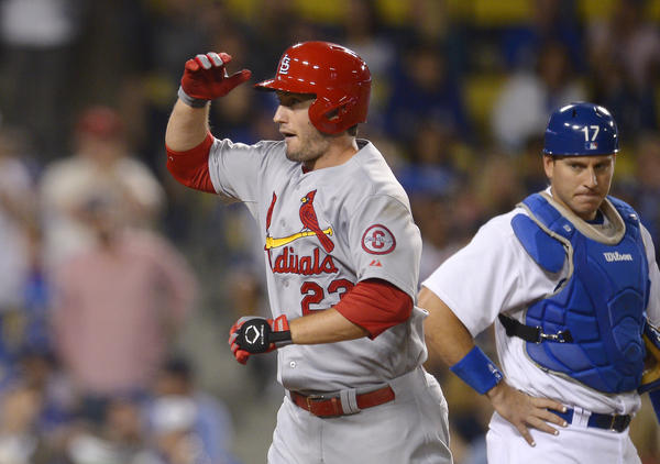 Cardinals third baseman David Freese celebrates after hitting a two-run home run against the Dodgers on Friday night.