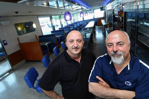 East Penn Diner co-owners and brothers George Draklellis, left, and Odiseas Draklellis pose in their new diner. The diner is scheduled to open in a few weeks.