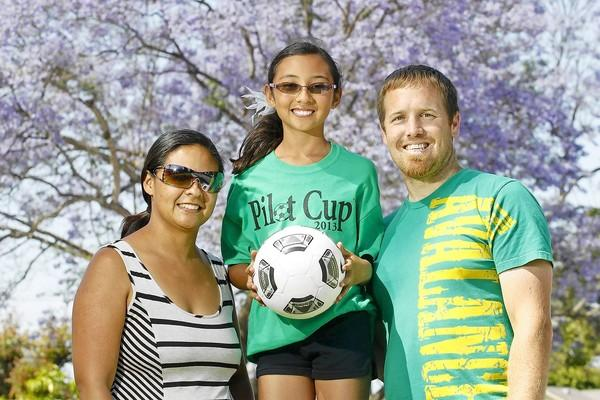 Daily Pilot Cup Coach Steve Whittaker, right, for the girls' fifth- and sixth-grade silver team at Killybrooke Elementary, poses for a photo with his daughter Lani, 10, center, one of his players, and wife Barbara, the school's liaison for the Pilot Cup.