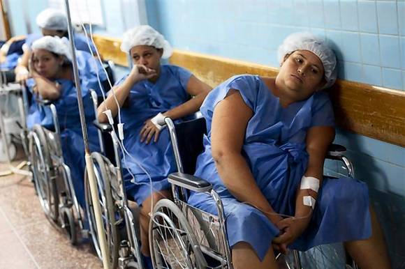 Pregnant women wait for their turn to undergo a Cesarean section procedure at the Santa Ana public maternity hospital in Caracas