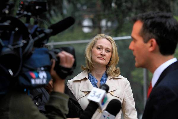 Amy Wakeland watches as her husband, Eric Garcetti, is interviewed after they voted at Allesandro Elementary School in the March 5 municipal election. Garcetti and Wendy Greuel advanced to the May 21 runoff, which he won.