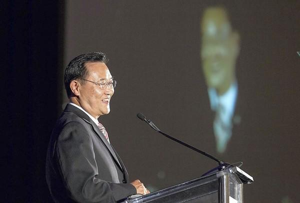 Irvine Mayor Steven Choi speaks during a business luncheon with the Irvine Chamber of Commerce on May 21.