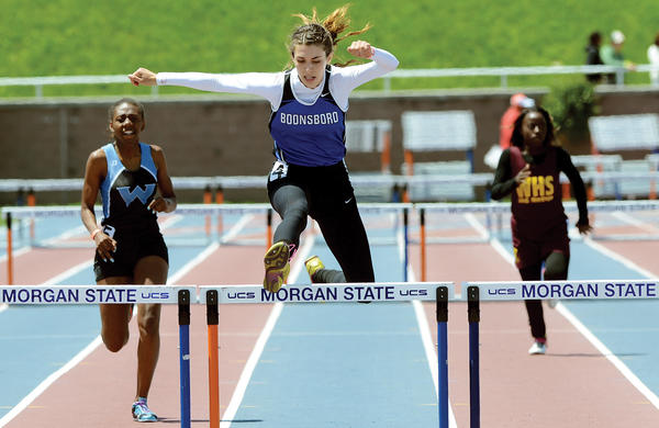 Boonsboro's Maggie Sullivan leaps a hurdle on the way to winning the Class 1A girls 100 hurdles title Saturday at the Maryland State Outdoor Track & Field Championships at Morgan State University in Baltimore.