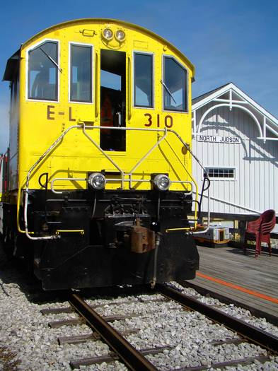 A former Erie Lackawanna switch engine, Number 310, sits outside the old train depot in North Judson, Indiana.