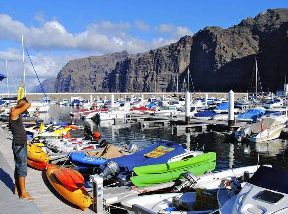 Recreational craft dock at the marina below Los Gigantes cliffs. This is popular port for whale watching in the straits between Tenerife and La Gomera.