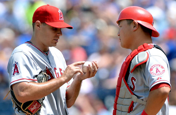 Angels catcher Hank Conger, right, visits pitcher pitcher Billy Buckner on the mound.