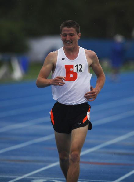 Grant Nykaza, a senior from Beecher, slows down as he wins the class 1A 1600-meter run on Saturday, March 25, 2013.