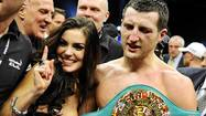 "Britain's Carl ""The Cobra"" Froch holding the WBC super middleweights belt celebrates with wife Rachael Coardingly after defeating Germany's ""King"" Arthur Abraham in their WBC super middleweights title bout at boxing event of Super Six World Boxing Classic in Helsinki November 27, 2010."