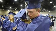 OKLAHOMA CITY — Before 18-year-old Zach Joyner rushed into a storm shelter Monday, he made sure to grab two prized possessions: his blue Southmoore High School graduation cap and gown.