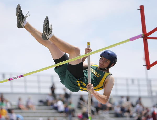 Aberdeen Roncalli's Colton Cox approaches the bar on his way to clearing 11 feet three inches in the pole vault Saturday at the South Dakota State Track Meet at Howard Wood Field. Though he did not place, Cox cleared a personal best of 11 feet nine inches. photo by john davis taken 5/25/2013