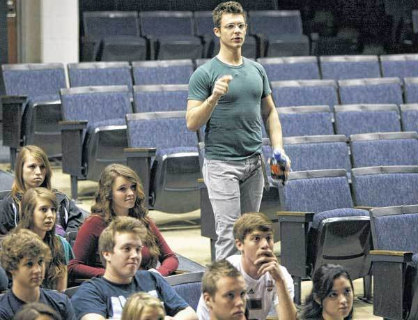 "David Nathan Perlow, stage actor in the production of ""Wicked"" that played at the Morris Performing Arts Center, conducts a workshop for students in the two show choirs at New Prairie High School."