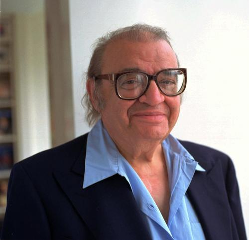 "Mario Puzo, author of ""The Godfather,"" was brought up in a poor family in New York. He served in Germany in World War II and later went to college on the GI Bill."
