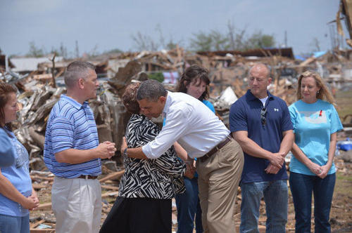 President Barack Obama is greeted as he tours a tornado affected area on May 26, 2013 in Moore, Oklahoma.