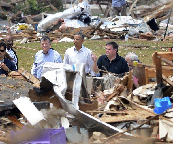 President Obama tours the devastation Sunday in Moore, Okla., left by last week's tornado that ripped through the Oklahoma City area, killing 24.
