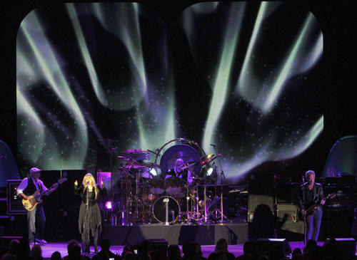 John McVie, left, Stevie Nicks, Mick Fleetwood and Lindsey Buckingham of Fleetwood Mac play the Hollywood Bowl on Saturday, halfway through a three-month North American tour.