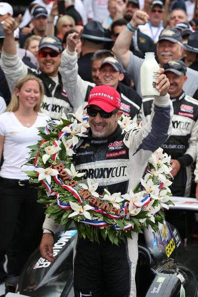 IndyCar Series driver Tony Kanaan holds up a bottle of milk after winning the 2013 Indianapolis 500 at Indianapolis Motor Speedway.